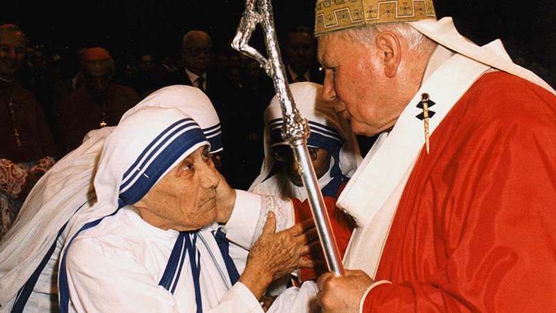 In this Sunday, June 29, 1997 filer, of Pope John Paul II greets Mother Teresa of Calcutta as they meet in St. Peter's Basilica at the Vatican. Mother Teresa will be made a saint on Sept. 4 2016 (AP Photo)