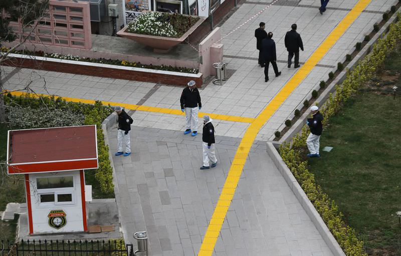 Forensic experts investigating the scene of the explosion the day after a suicide car bombing in Ankara, killied at least 35 people and wounding 125 (AFP Photo)