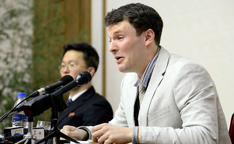 This file photo taken on February 29, 2016 shows US student Otto Frederick Warmbier (R), who is arrested for committing hostile acts against North Korea, speaking at a press conference in Pyongyang (AFP Photo)