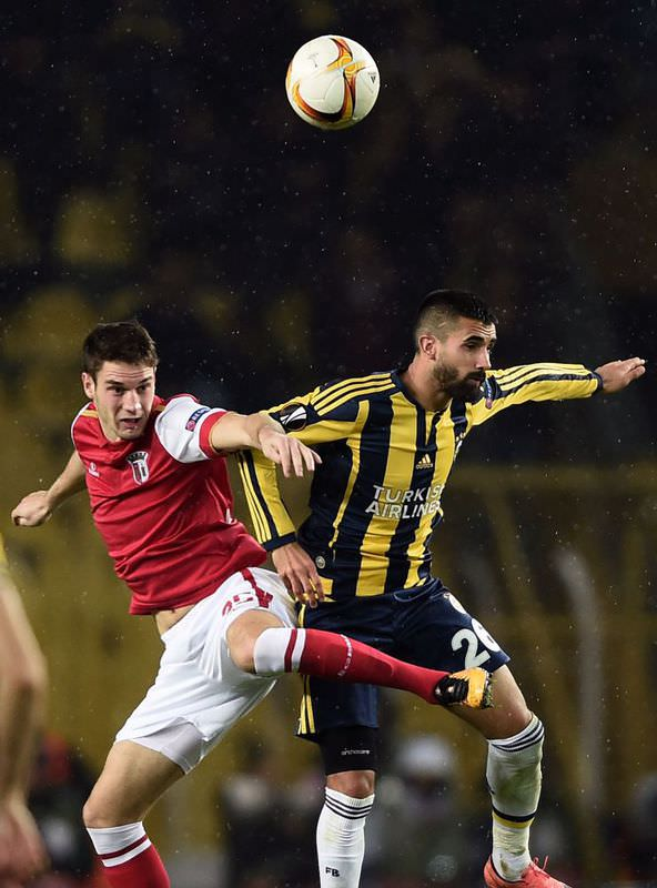 Braga's Baiano (L) vies for the ball with Fenerbahu00e7e's Alper Potuk (R) during the UEFA Europa League round of 16 football match between Fenerbahce and Braga on March 10 at u00dclker u015eu00fckru00fc Sarau00e7oglu stadium in Istanbul.