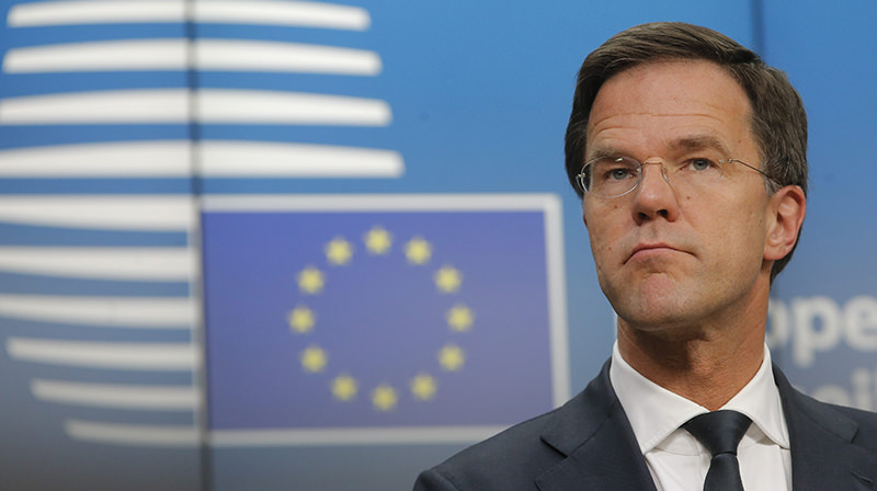 Dutch Prime Minister and current EU President Mark Rutte speaks during a joint press breifing at the end of a tripartite social summit, one day ahead to the March European Summit, in Brussels, Belgium (EPA Photo)
