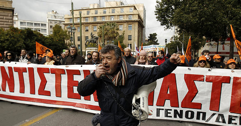 Members of Greece's public power corporation workers union (GENOP) march during a protest in Athens February 9, 2012. (Reuters Photo)