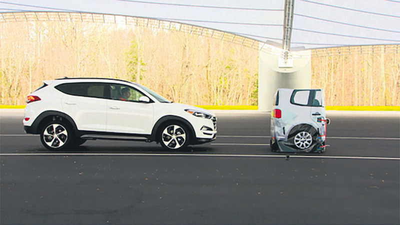 In this frame grab from video provided by the Insurance Institute for Highway Safety, a vehicle closes in on a Strikeable Surrogate Vehicle (SSV) at the IIHS Vehicle Research Center in Ruckersville, Virginia.