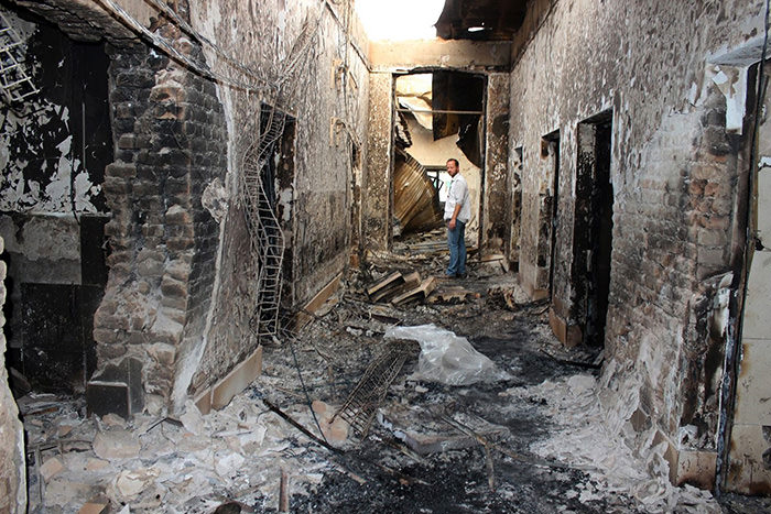 In this Oct. 16, 2015, file photo, an employee of Doctors Without Borders stands inside the charred remains of their hospital after it was hit by a U.S. airstrike in Kunduz, Afghanistan (AP Photo)