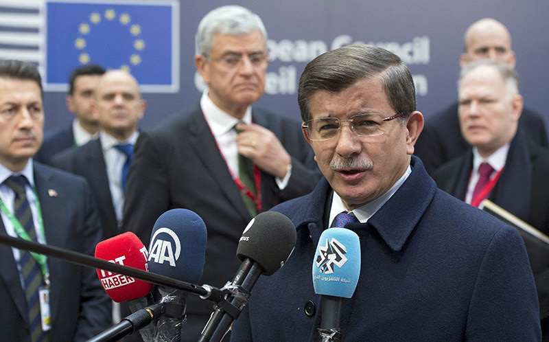 Prime Minister Ahmet Davutoglu speaks to media as he arrives for a meeting during a two-days European Union leaders summit in Brussels, Belgium, 18 March 2016. (EPA Photo)