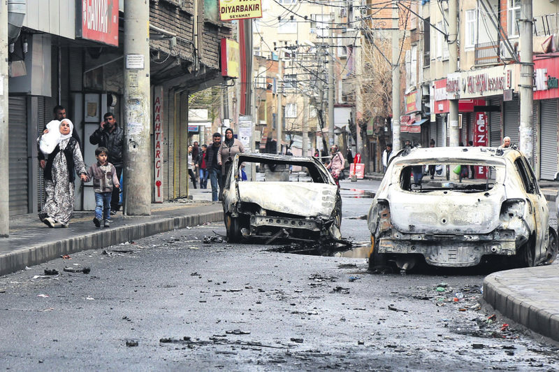 Residents of Bau011flar district in Diyarbaku0131r carrying their belongings as they leave after clashes between the Turkish security forces and PKK militants.