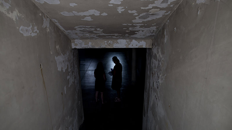 Women stand inside the basement that served as an admitting area for detainees at the former Argentine Navy School of Mechanics, in Buenos Aires, Argentina, Wednesday, March 16, 2016. (AP Photo)