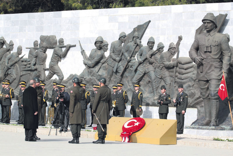 Erdou011fan, accompanied by honor guards, lays a wreath at a monument for the u00c7anakkale dead. Thousands of Ottoman troops died in 1915 in an area near the monument. (IHA Photo)