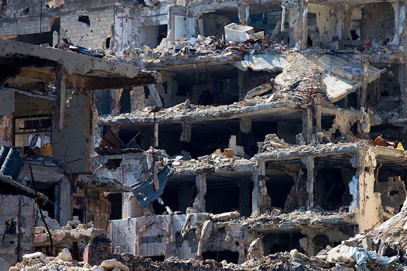 In this picture taken Friday, Feb. 26, 2016, destroyed buildings are seen in the old city of Homs, Syria (AP Photo)