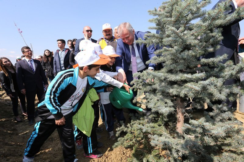 Students and local officials  water a tree they planted in the western city of Denizli yesterday. Turkey marked International Day of Forests yesterday through nationwide planting events.