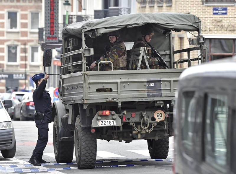 Police and military patrolling the city center after the explosions in Brussels