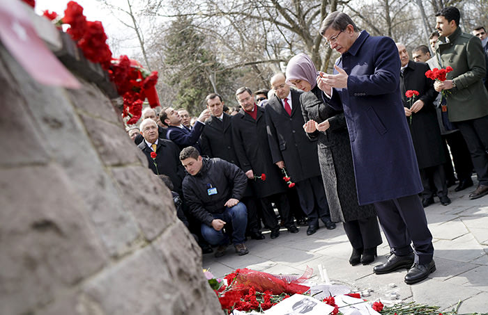 Prime Minister Ahmet Davutou011flu and his wife Sare Davutou011flu pray at the site of Sunday's suicide bomb attack, in Ankara, Turkey March 17, 2016 (Reuters Photo)