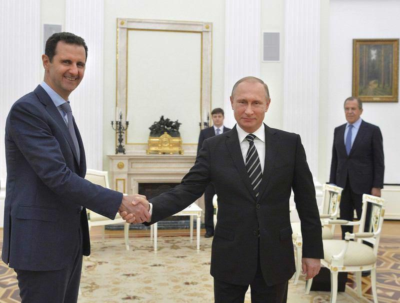 Syria's Bashar Assad(L) shakes hands with Russian President Vladimir Putin.
