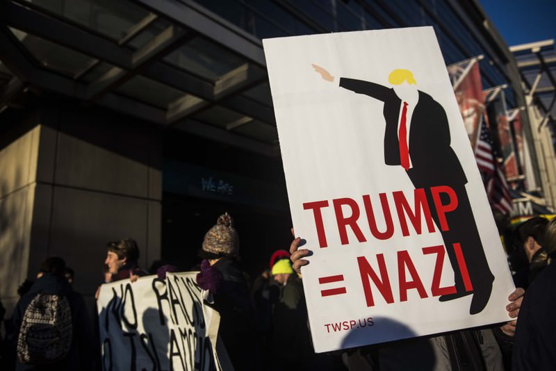 People demonstrate against Trump's racist rhetoric outside of the Verizon Center during the American Israel Public Affairs Committee (AIPAC) conference in Washington.