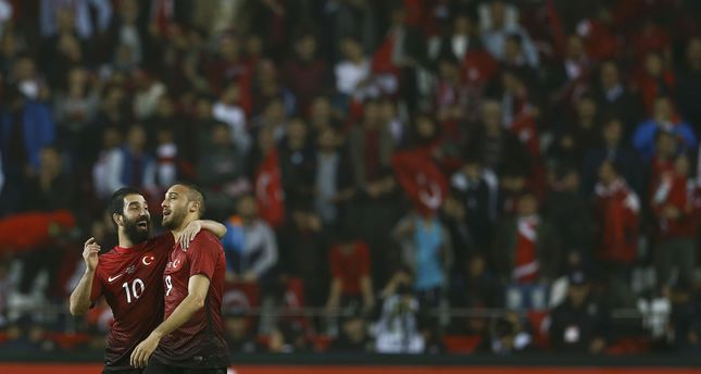 Turkey's Cenk Tosun celebrates with Arda Turan after scoring a second goal against Sweden (REUTERS Photo)