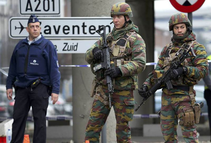 Belgian troops and police controlling a road leading to Zaventem Airport following Tuesday's airport bombings in Brussels.