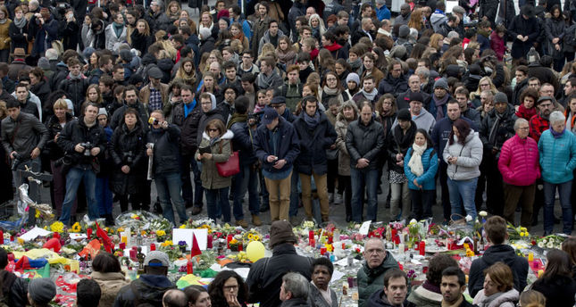 People gathered to observe a minute of silence and mourn for the victims of the bombings at Place de la Bourse in the center of Brussels, Belgium on Thursday.