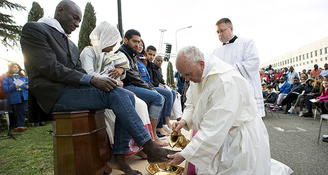 Pope Francis washes the foot of a refugee during the foot-washing ritual at the Castelnuovo di Porto refugees center near Rome, Italy, March 24, 2016. (Reuters Photo)