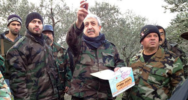 Undated file photo shows Mihraç Ural (C) and members of his armed group in Syria.