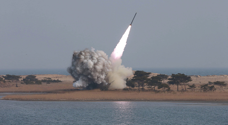 An undated handout file photograph made available on 04 March 2016 by the North Korean news agency KCNA shows the test-firing of new-type large-caliber multiple launch rocket system by the North Korean military (EPA Photo)