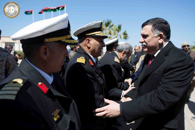 Fayez Serraj (R), head of the U.N.-brokered unity government, arrives in Tripoli with six deputies.