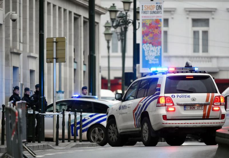 Police block the street outside the Brussels court where two terrorism cases will be heard on March 31.