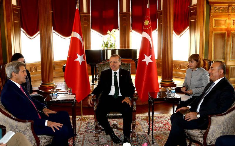 President Erdou011fan (C) and Turkish Foreign Minister Mevlu00fct u00c7avuu015fou011flu (R) welcomed U.S. Secretary of State John Kerry (L) at Turkey's Washington Embassy.