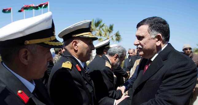 Fayez Serraj (R), head of the U.N.-brokered unity government, arrives in Tripoli with six deputies.