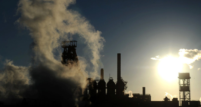 The sun sets as smoke and steam rises from the Tata Steel plant in Port Talbot, Wales, after the steel giant confirmed plans to sell its U.K. assets.