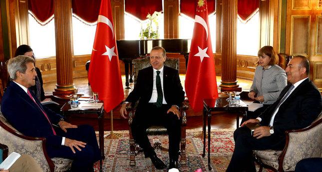 President Erdoğan C and Turkish Foreign Minister Mevlüt Çavuşoğlu R welcomed U.S. Secretary of State John Kerry L at Turkey's Washington Embassy.