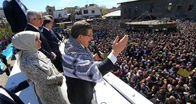 Turkey's Prime Minister Ahmet Davutoglu addresses his supporters a day in Diyarbakir, Turkey, Friday, April 1, 2016. (AP Photo)