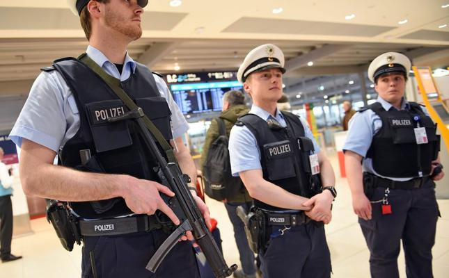 Members of the German police patrol an area of the Cologne Bonn Airport in Cologne, Germany on March 22.