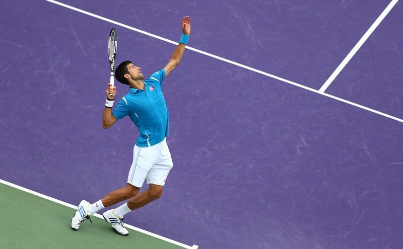 Novak Djokovic of Serbia serves against Kei Nishikori of Japan in the mens final during the Miami Open. (AFP Photo)