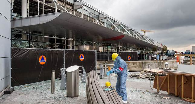 A forensics officer works in front of the damaged Zaventem Airport terminal in Brussels. (AP Photo)