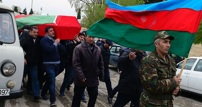 Men carry coffin of Azerbaijan's serviceman, who was killed on April 2 during clashes between Armenian, Azeri forces in Armenian-seized Azerbaijani region of Karabakh (AFP)