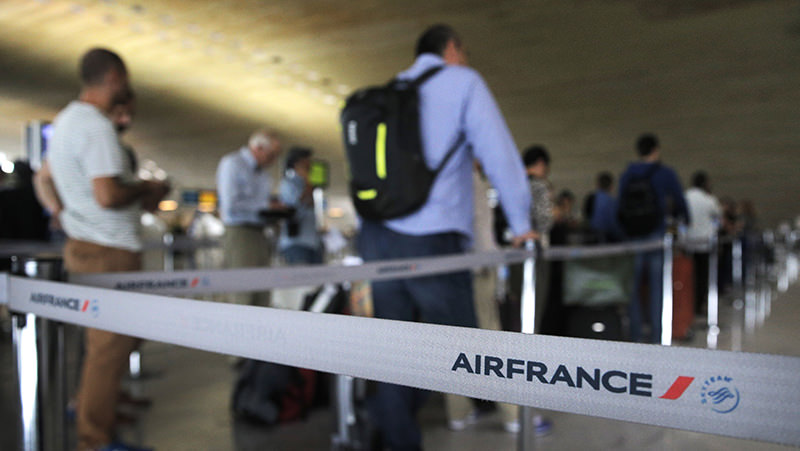 In this Sept.17, 2014 file photo, travellers wait at an Air France customer service desk at Paris Charles de Gaulle airport, in Roissy, near Paris (AP Photo)