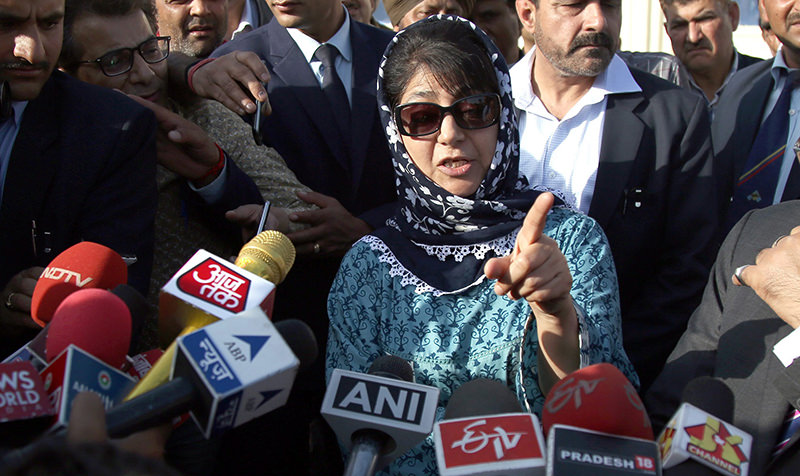 People's Democratic Party (PDP) president and Parliament member, Mehbooba Mufti speak to the media after a meeting with Jammu and Kashmir Governor NN Vohra (EPA Photo)