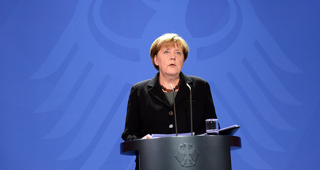 German Chancellor Angela Merkel delivers a statement following the death of former German foreign minister Hans-Dietrich Genscher. (EPA Photo)