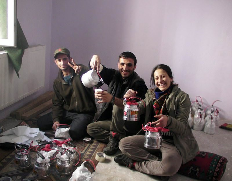 Senior PKK terrorist Emel Gu00fcu00e7lu00fc (R) poses with explosives-filled teapots.