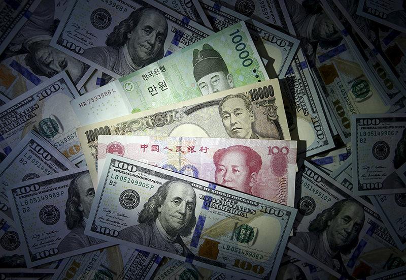 South Korean won, Chinese yuan and Japanese yen notes are seen on U.S. 100 dollar notes in this file photo illustration shot December 15, 2015. (REUTERS Photo)