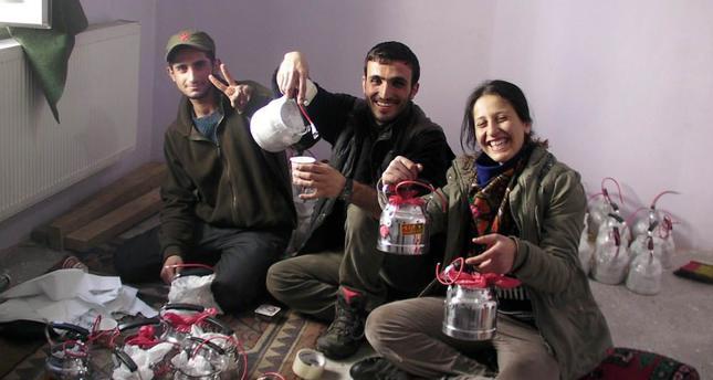Senior PKK terrorist Emel Güçlü (R) poses with explosives-filled teapots.