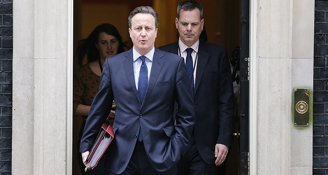 Britain's Prime Minister David Cameron leaves 10 Downing Street for Prime Minister Questions at the Houses of Parliament in London, Wednesday, March 23, 2016 (AP Photo)