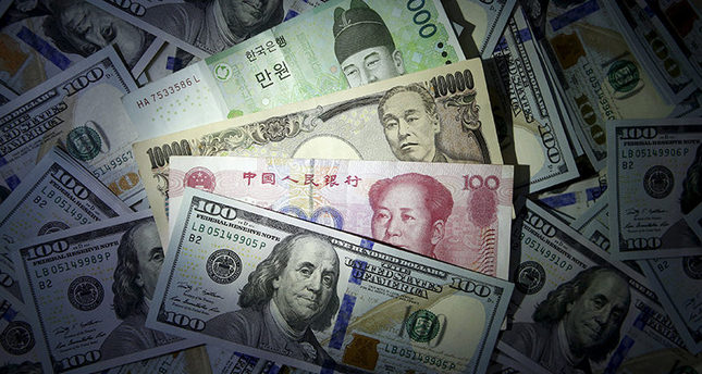 South Korean won, Chinese yuan and Japanese yen notes are seen on U.S. 100 dollar notes in this file photo illustration shot December 15, 2015. REUTERS Photo