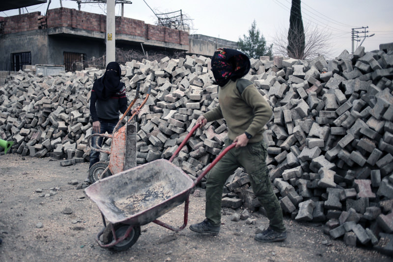 PKK militants setting up a barricade before attacking Turkish security forces in Nusaybin in southeast Turkey.