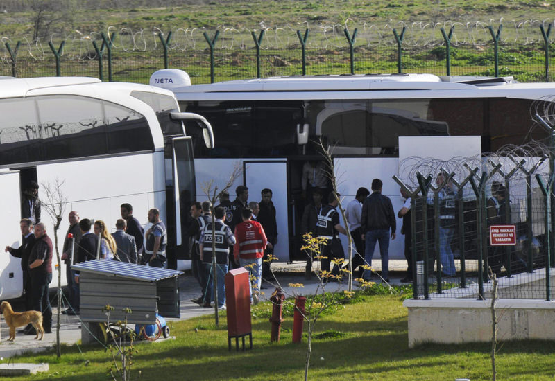 Police surround migrants as they arrive in a facility in Ku0131rklareli's Pehlivanku00f6y which will house migrants scheduled for deportation to their home countries.