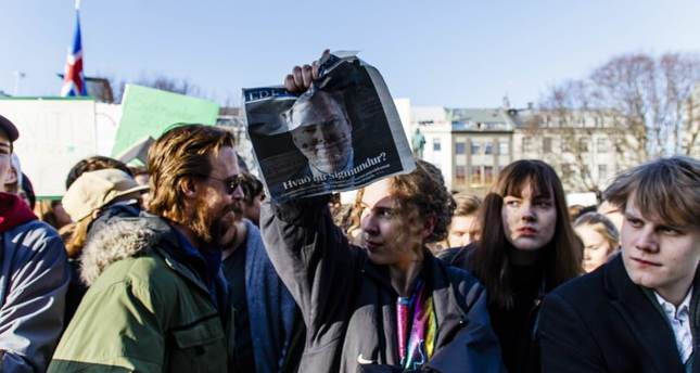 People at a protest in Austurvollur Square in front of Iceland's parliament building in Reykjavic on April 4.
