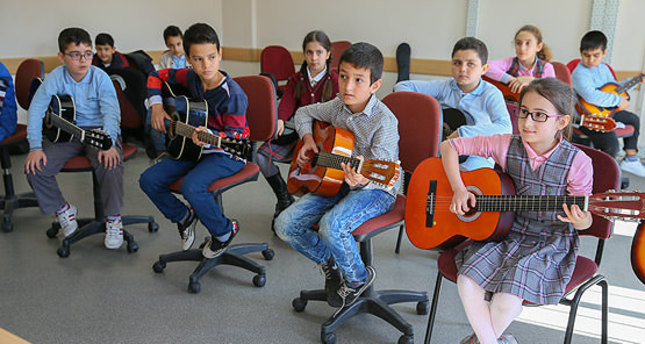 Syrian children color their world with art, music courses