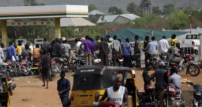 People line up at a gas station in Okene, Nigeria. Nigeria's oil minister apologized this week for a fuel shortage that has created long lines at gas stations and left travelers stranded on highways in  sub-Saharan Africa's top oil-producing country.