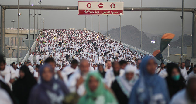 Hundreds of thousands of Muslim pilgrims make their way to cast stones at a pillar symbolizing the stoning of Satan, in a ritual called Jamarat, the last rite of the annual hajj (AP Photo)