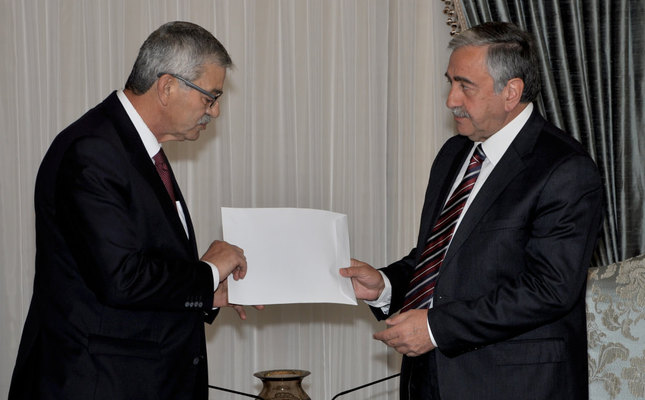 Turkish Cypriot Prime Minister Kalyoncu L submitting his resignation to President Akıncı after his coalition partner withdrew from the government.